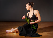 Young ballerina with flower Royalty Free Stock Photography