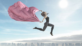 The young ballerina flying over a city Royalty Free Stock Photos