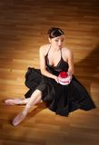 Young ballerina with gift Royalty Free Stock Images