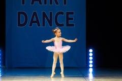 Young Ballerina girl dancing on stage Stock Image