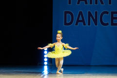 Young Ballerina girl dancing on stage Stock Photo
