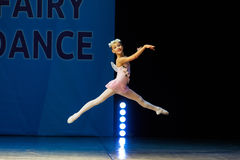 Young Ballerina girl dancing on stage Royalty Free Stock Photos