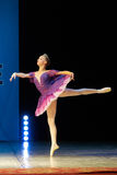 Young Ballerina girl dancing on stage Royalty Free Stock Image