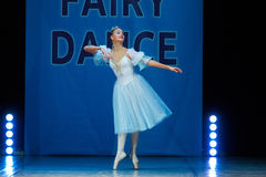 Young Ballerina girl dancing on stage Stock Images