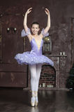 Young ballerina in a lilac Royalty Free Stock Photo