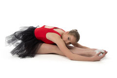 Young ballerina makes stretching exercises Stock Photo