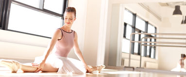 Young Ballerina in Pink Doing Splits in Studio Royalty Free Stock Photos