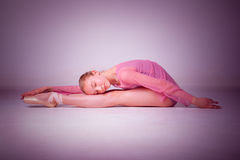 The young ballerina posing on the floor Royalty Free Stock Images