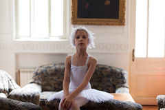 Young ballerina posing on a sofa Stock Image
