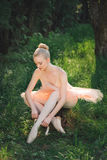 Young ballerina preparing for dance outdoors Royalty Free Stock Image