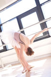 Young Ballerina Stretching at Barre in Studio Royalty Free Stock Photos