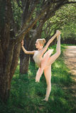 Young ballerina stretching and do exercise before dance outdoors Stock Photos