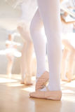 Young ballerina wearing pointe shoes in class Stock Photos