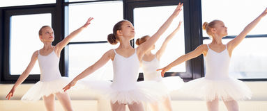 Young ballerinas practicing a choreographed dance Stock Photography