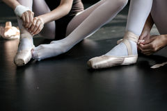 Young ballerinas putting their pointes on stock photo