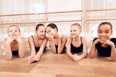 Young ballerinas rest during a break in the ballet classes. The girls communicate with each other at the ballet school. They want to become dancers stock photos