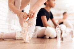 Young ballerinas rest during a break in the ballet classes. The girls communicate with each other at the ballet school. They want to become dancers stock photography