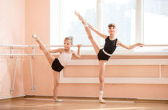 Young ballerinas standing at barres Stock Photo