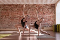 Young ballerinas workout. Synchronized work. Sport for girls, ladies dancing in class. Gym background with free space, healthy teenager lifestyle, femininity Stock Photos