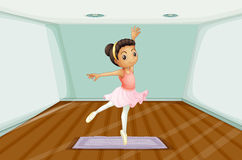 A young ballet dancer dancing above the rug Royalty Free Stock Images