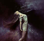 Young ballet dancer dancing with the dust. Young ballet dancer dancing with the colorful dust Royalty Free Stock Images