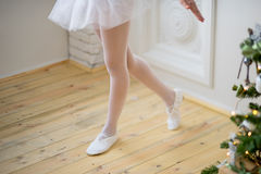 Young ballet dancer learning the lesson. Try some new pose Royalty Free Stock Photos