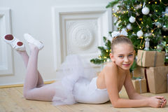 Free Young Ballet Dancer Lying Near Christmas Tree Stock Photography - 83636752