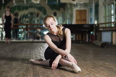 Young ballet dancer practicing in class. stock image