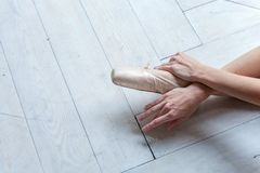 Young ballet-dancer sitting on the floor stock photo