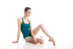 Young ballet dancer sitting on floor Royalty Free Stock Images