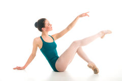 Young ballet dancer sitting on floor Stock Photo