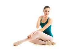 Young ballet dancer sitting on floor Stock Photography