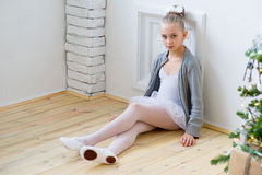 Free Young Ballet Dancer Sitting Near Christmas Tree Royalty Free Stock Image - 83636306