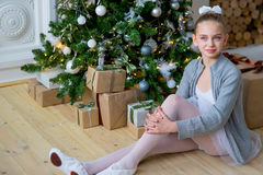 Young Ballet Dancer Sitting Near Christmas Tree Royalty Free Stock Images