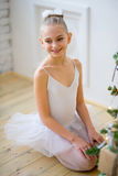 Young Ballet Dancer Sitting Near Christmas Tree Stock Photos