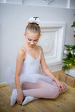 Young Ballet Dancer Sitting Near Christmas Tree Royalty Free Stock Photos