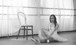 Young ballet dancer on a warm-up. The ballerina is preparing to Royalty Free Stock Photography