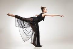 Young ballet dancer wearing black transparent dress dancing Royalty Free Stock Photos
