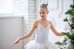 Young ballet dancers learning the lesson near Christm. Young ballet dancers learning the lesson near the wall. Try some new pose Stock Photography