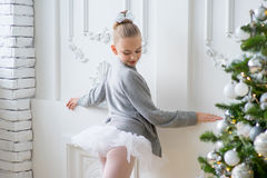 Young ballet dancers learning the lesson near Christm. Young ballet dancers learning the lesson near the wall. Try some new pose Stock Image