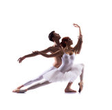 Young ballet dancers performing on white. Young couple of ballet dancers performing. Image is isolated on white Stock Photography