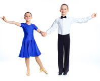 Young ballroom dancers. In formal costumes posing. Isolated on white background Stock Photography