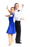 Young ballroom dancers. In formal costumes posing. Isolated on white background Royalty Free Stock Image