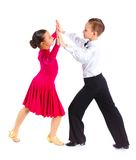 Young ballroom dancers. Clouseup portrait of young ballroom dancers in formal costumes posing. Isolated on white background Stock Photo