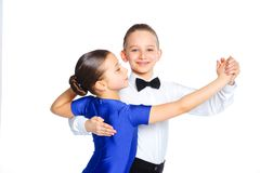 Young ballroom dancers. Clouseup portrait of young ballroom dancers in formal costumes posing. Isolated on white background Royalty Free Stock Image