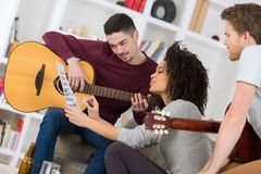Young band music composing at home. Teen stock photo