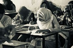Bangladesh Children seats for the examination in the school royalty free stock photography