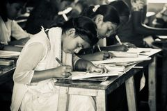 Bangladesh Children seats for the examination in the school. Young Bangladeshi children are giving final school examination in the month of December unique stock photo