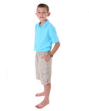 Young barefoot boy in shorts Stock Image