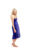 Young barefoot lady in blue dress Stock Photo